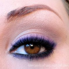 """This is so simple, and I love the purple. Supposedly, you just rim (Ha! I said """"rim!"""") your eyes with black eyeliner and then make the liner smoky by adding purple eye shadow. This is a look I'll have to take to my make-up artist. If I do it, people will think my boyfriend gave me a black eye."""
