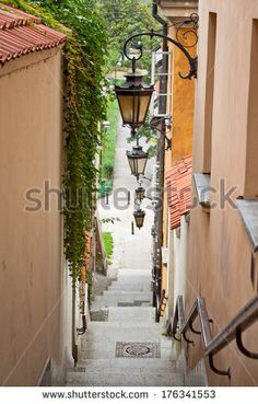 Narrow street with stairs and lamps in the Old town of Warsaw, Poland