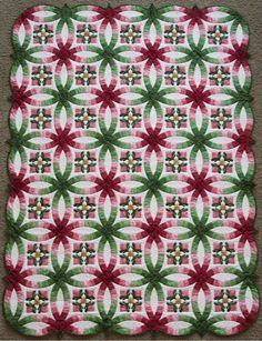 Caroline's Wedding from the Elm Creek Quilts Collection - Pieced and appliquéd by Jennifer Chiaverini. Quilted by Sue Vollbrecht.