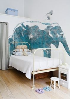 very cool elephant mural watercolor I just LOVE this wall dressing. single bed against it.  Love it for a boys bedroom. Also very cool above wardrobe storage. siple and sweet.