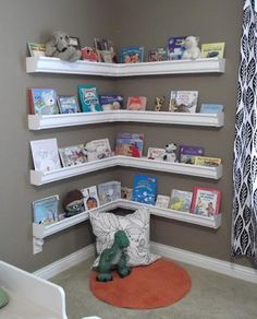 DIY Rain Gutter Kid's Bookshelves This could be the best 're-purposing' project I have seen so far....what a great idea and the books, or whatever, would not fall off the 'shelves'...WOW