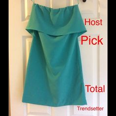 Zara Teal Dress Zara teal dress. It have very pretty ruffle detail in the back. Very cute one. It have a little white spot when I bought it but it look like it can be remove. The up close photos for spot is the color of the dress. It doesn't fit me anymore. Price is FIRM. Will keep until it fit me again if I can't sell for that price. Thanks Zara Dresses