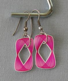 These are shrinky-dink earrings made with a spirograph and a hot pink sharpie