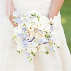a palette of soft pastel colors. The bride's bouquet combined the flowers from the four different bridesmaid bouquets, including garden roses, light-pink stock, purple hydrangeas and purple roses.