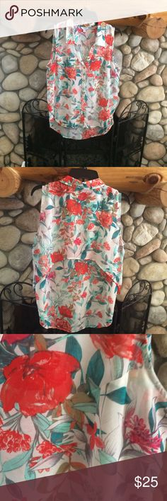 GUESS BRIGHT FLORAL SLEEVELESS BLOUSE CUTE FLORAL DARK ORANGE AND GREEN ON WHITE BACKGROUNDS. BUTTON DOWN CHIFFON MATERIAL AND EXTRA LAYER IN UPPER BACK. SEE PHOTO  LIKE NEW. TAGE REMOVED Guess Tops Blouses