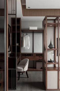 Great dressing room #design with wood and cream coloured accents.