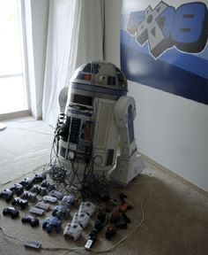 other than the fact that R2D2 looks like he's undergoing maintenance, this is amazing!! [The 8 Game Console & Projector R2-D2]