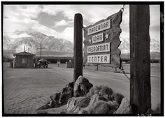 WWII Ansel Adams photo of Manzanar Relocation Center entrance in California. During WWII, ethnic Japanese residents and citizens of the United States were moved by federal order to relocation camps. Sierra Nevada, Best Photographers, Landscape Photographers, Des Photos Saisissantes, Ansel Adams Photos, Yosemite Camping, National Gallery, Haunting Photos, Pearl Harbor Attack