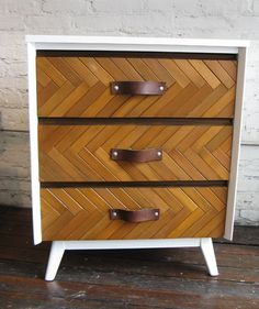 MCM chest restyled with slats from old interior shutters and leather straps as pulls