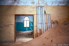 Once a thriving diamond town, now a ghost town being swallowed by the desert - take an eery walk through Kolmanskop as the Namib desert encroaches. Namib Desert, Ghost Towns, Abandoned Places, Us Travel, Deserts, Africa, Room, Painting, Inspiration