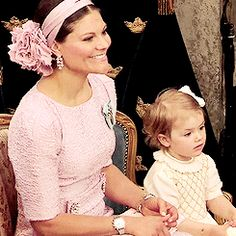 Crown Princess Victoria of Sweden with Princess Estelle at the christening of Princess Madeleine's first-born Princess Leonore in the Chapel at Drottningholm Palace, June 8th 2014