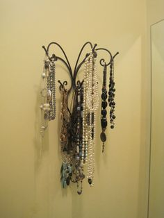Easy Necklace holder...reminds me of one of those old fashioned towel holders with 5-6 moveable arms...that would be pretty cool
