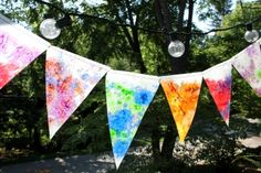 """Buntings are kind of done to death (but I still love them). Finally something new! Crayon shavings/wax paper """"stained glass"""". Sounds lovely for someplace sunny."""