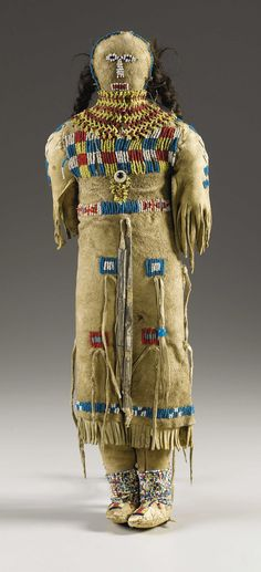 A PLAINS BEADED HIDE FEMALE DOLL. . c. 1890. ... American Indian | Lot #77204 | Heritage Auctions