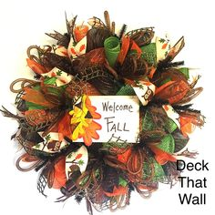 This gorgeous fall wreath is made with three different colors of mesh, featuring…