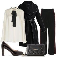 Pantalone di velluto nero con banda laterale rossa e camicia di seta con fiocco a contrasto. Cappotto classico con finiture in similpelle. Décolleté nere di vernice e pochette Love Moschino per rifinire il tutto.