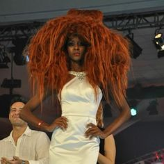 Wild coppery hair from Australia at the Farouk Cancun Conference.