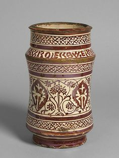 Pharmacy Jar Date: first half 15th century Geography: Made in probably Manises, Valencia, Spain Culture: Spanish Medium: Tin-glazed earthenware Dimensions: Overall: 7 3/16 in. (18.3 cm)