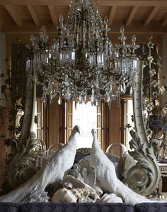 wow - opulence at it's best. white peacocks, chandelier, mirror, layered with love and style.
