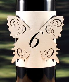 Laser Cut Wine Bottle table number wrap. Clever. DIY wedding project.