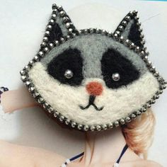 This beautifull Raccoon is made from pure sheep wool and silver zipper. Safety pin at back. free shipping