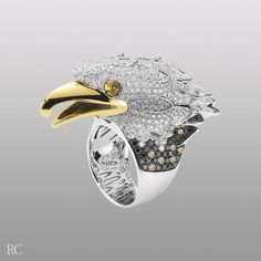 Google Image Result for http://en.robertocoin.com/admin/products/1048/gallery/files/anello_eagle_oro_bianco_big.jpg