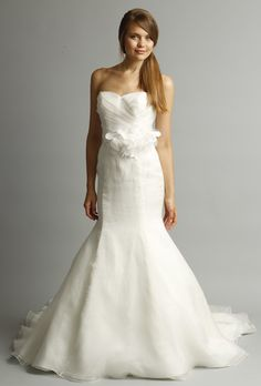 Fabric petals adorn the waist of this wedding dress from Alyne by Rivini's spring 2013 collection