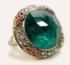 Stunning emerald, ruby and diamond ring