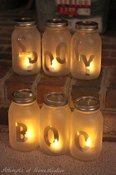 Frosted glass mason jar lantern from @aadomestication | DIY Halloween Decor