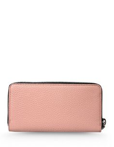 This pink color clutch features zip pockets and had lined interior.
