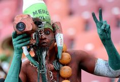A Niger supporter poses with a camera during the Africa Cup of Nations football match against Ghana at the Nelson Mandela Bay Stadium in Port Elizabeth, South Africa Picture: STEPHANE DE SAKUTIN/AFP/Getty Images Ghana, Port Elizabeth South Africa, Cruise Port, Football Match, Man In Love, World Traveler, Pictures, Photos, Stephane