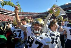 Georgia Tech place kicker Harrison Butker (87) and other players celebrate their 28-27 win over Georgia with a piece of the Sanford Stadium hedges at Sanford Stadium on Saturday, November 26, 2016. HYOSUB SHIN / HSHIN@AJC.COM