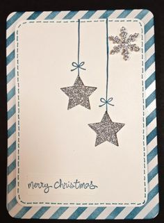 handmade Christmas card from distINKtive STAMPING designs ,,, silver glitter paper stars hanging from lines with bows .... like the clean and simple styling ... Stampin' Up!
