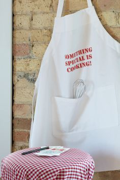 Diner Apron. Wearable accessories can make the baby shower theme come to life.
