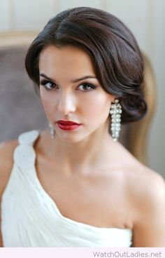 Low bun wedding hairstyle and makeup, love the earrings too