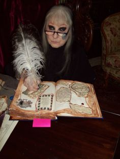 laurie working on a book of shadows . each one is made to order just for you no 2 are alike . takes laurie 3 to 4 months to make one. for order info  www.theofficialwitchshoppe.net