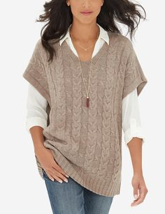I have this sweater and love it!  I usually wear a long sleeve T-shirt under it though.  I should try a blouse!
