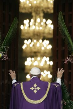 Pope Francis opening the Holy Door at St. Peter's Basilica in Rome.