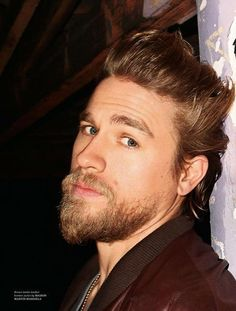 Charlie Hunnam. God, his hair is..... There are no words for his hair. I don't think I'll be able to cope with his hair like this next season. I'll combust with longing.