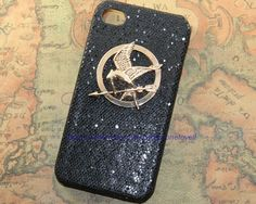 Gloden Hunger Games Logo PU leather case for iPhone 4 Case, iPhone 4s Case, iPhone 4 Hard Case. $8.99, via Etsy.