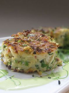 Mouth watering spicy crab cakes -This recipe for Spicy Crab Cakes combines lots of cilantro, scallions and a few other Asian flavors to balance the sweet flesh of the crab.
