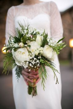 winter wedding bouquet with ferns cedar bough babies breath and rose with lace wedding dress with long sleeve at willowdale estate topsfield ma zev fisher (683x1024)