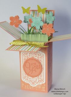 A Fun Pop Up Card Made with Stampin' Up!'s Petite Petals stamp set and Punch  click here to see a video on how to make it