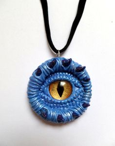 Mystical Blue and Gold Dragon eye pendant by AurorasLocket on Etsy