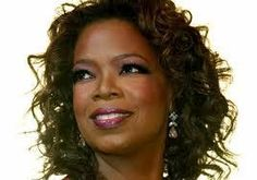 Another great shot of Oprah! She's probably spend millions helping needy people.