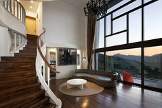 House on the Cliff by Studio_GAON. Those stairs are outstanding.