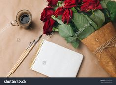 Open Empty Notebook With Cup Of Coffee, Brushes And Bouquet Of Roses Flowers…