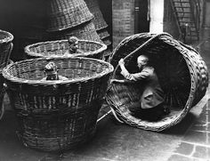 Men at work at the Cardiff Institute, making huge baskets, unique in size and construction, for loading oil cake in South Africa, 1938