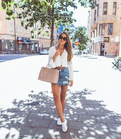 #fashion #style #stylish #love #me #cute Fashion Ideas For Women #nails #hair #beauty #beautiful #pretty #swag #pink #girl #girls #eyes #design this look has style! #model would you like to visit my site to see more? #dress #shoes #heels #styles #outfit #pursDistressed and frayed denim skirts are always a winner! Kenza Zouiten pairs this cute vintage style skirt with a cropped white blouse and sneakers, creating an easy and stylish summer look. Skirt: Asos, Top: H&M, Shoes: Superga, Bag…
