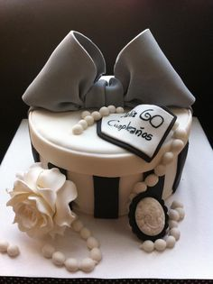 Black and white striped hat box cake with pearls.